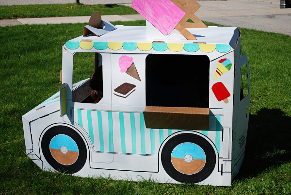 Cardboard ice cream truck playhouse nature moms for How to make a cardboard box car that moves