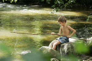 boy fishing camping