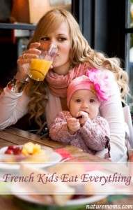 Young mother and daughter having breakfast together in a Paris