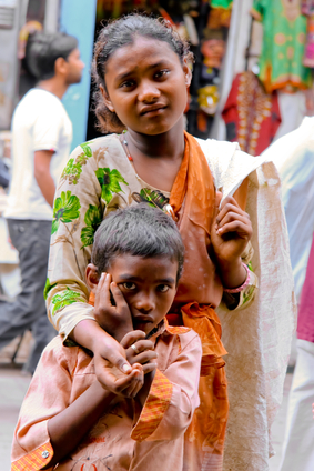 Two children begging